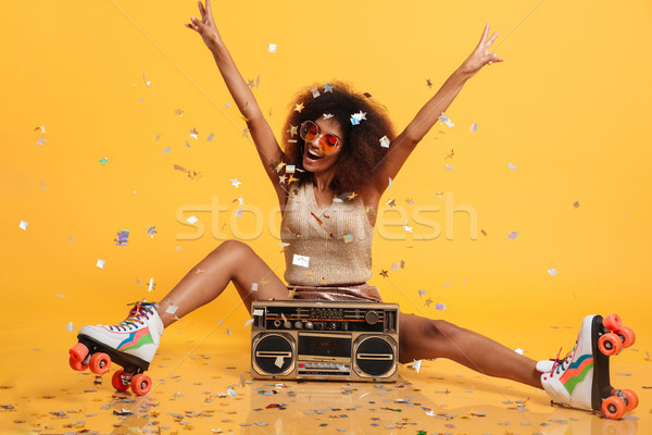 Beautiful young african woman with afro hairstyle throwing confe Stock photo © deandrobot