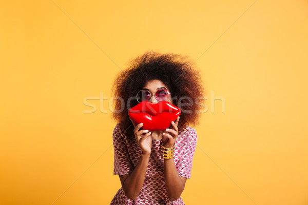 Pretty retro stylish african woman having fun while posing with  Stock photo © deandrobot