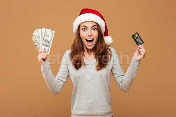Excited shocked caucasian lady holding money and credit card Stock photo © deandrobot
