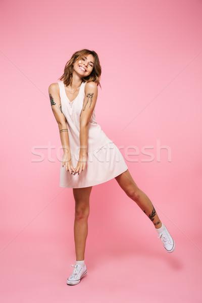 Full length portrait of a smiling girl in summer dress Stock photo © deandrobot