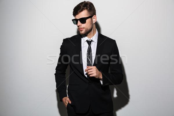 Retrato elegante hombre traje empate posando Foto stock © deandrobot