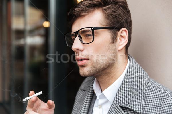 вид сбоку серьезный деловой человек очки пальто Сток-фото © deandrobot