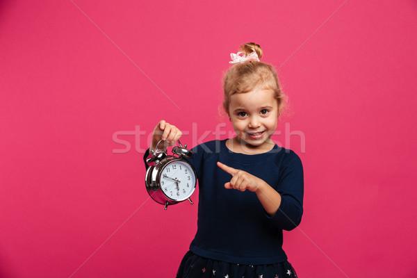 счастливым будильник указывая молодые Сток-фото © deandrobot