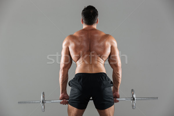 Back view portrait of a muscular shirtless male bodybuilder Stock photo © deandrobot