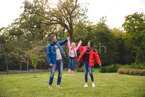 Young happy family of three spending time together Stock photo © deandrobot