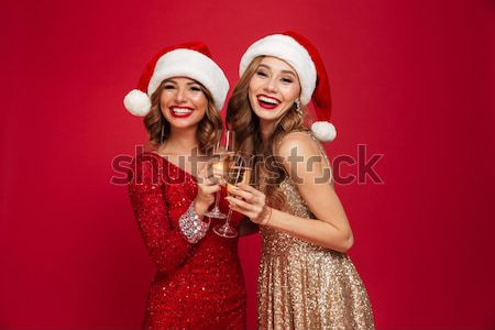 Portrait of a cheerful young girls dressed in shiny dresses Stock photo © deandrobot