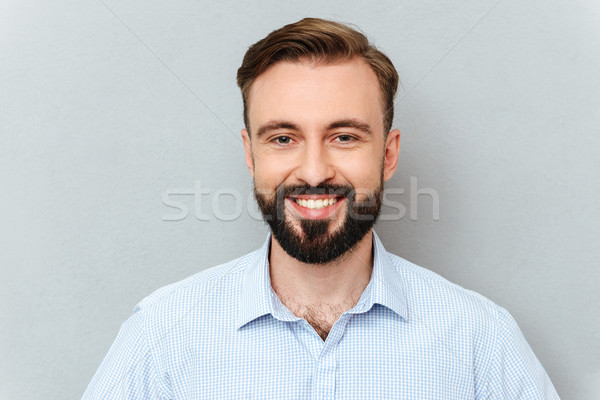 счастливым бородатый человека бизнеса одежды глядя Сток-фото © deandrobot