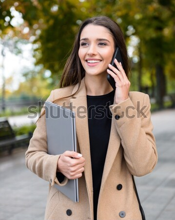 Close-up portrait of happy asian business woman chatting over on Stock photo © deandrobot