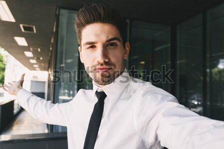 Portrait of a confident young businessman Stock photo © deandrobot