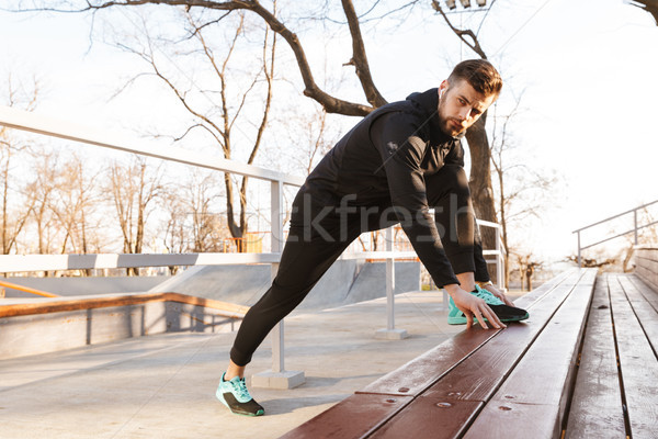 Portrait of motivated young sportsman in earphones Stock photo © deandrobot