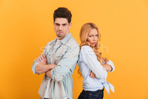 Photo of angry man and woman in denim clothes being in fight and Stock photo © deandrobot