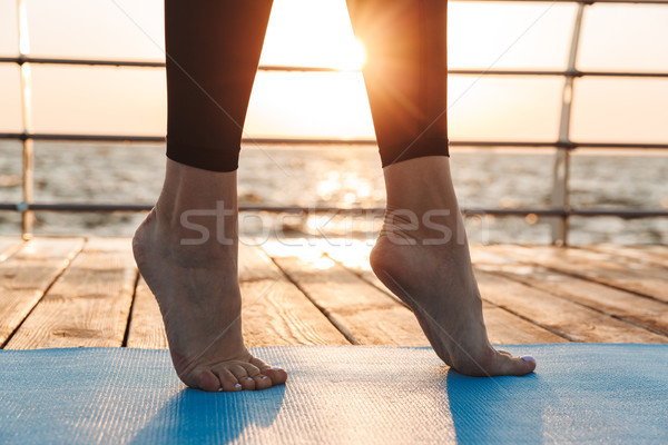 Close up of female legs in sport leggins standing on tiptoes Stock photo © deandrobot