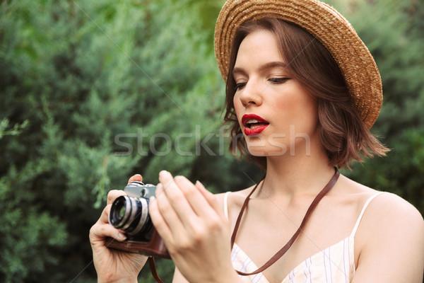 красоту женщину платье соломенной шляпе ретро камеры Сток-фото © deandrobot