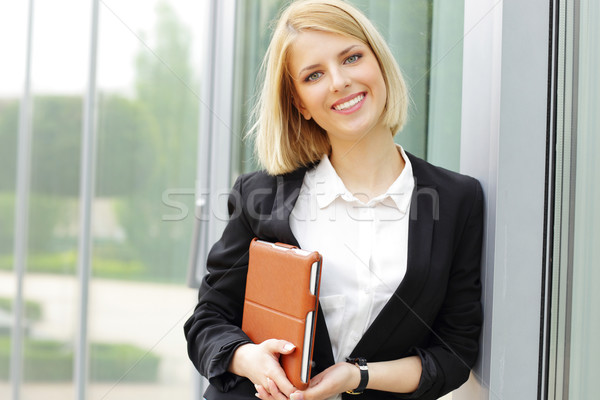 Portrait of a young beautiful cheerful woman Stock photo © deandrobot