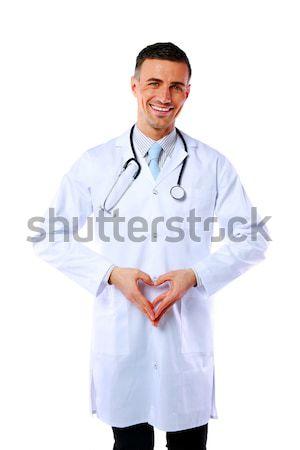 Portret uśmiechnięty mężczyzna lekarz kształt serca odizolowany Zdjęcia stock © deandrobot