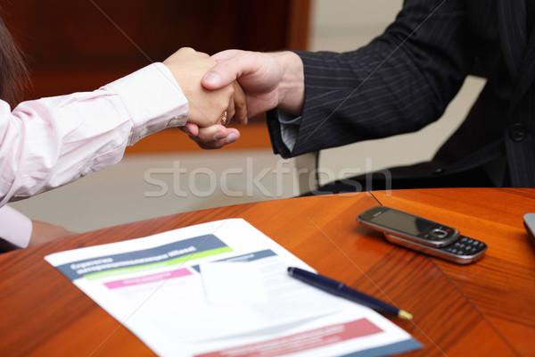 Uomo d'affari donna d'affari affrontare donna mani Foto d'archivio © deandrobot