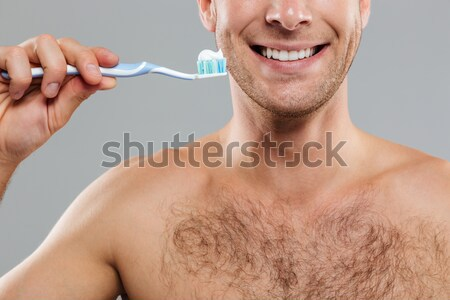 young man drinking water close up shoot  Stock photo © deandrobot