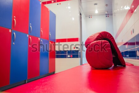 Tired man sitting on the floor in the locker room Stock photo © deandrobot