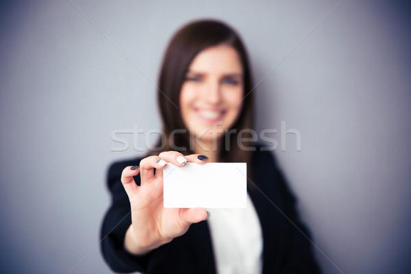 Kadın boş kart odak kart gri Stok fotoğraf © deandrobot