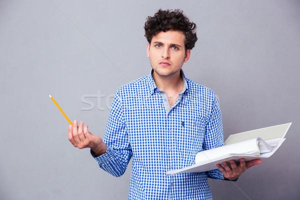 Uomo matita cartella file giovani Foto d'archivio © deandrobot