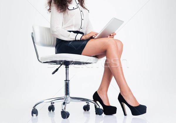 Closeup portrait of a woman using tablet compute Stock photo © deandrobot
