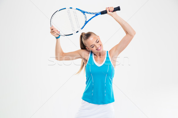 Cute woman standing with tennis racket  Stock photo © deandrobot