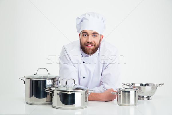 Mężczyzna kucharz gotować posiedzenia tabeli dania Zdjęcia stock © deandrobot