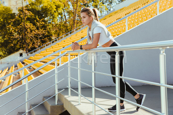 Sports woman standing at stadium Stock photo © deandrobot