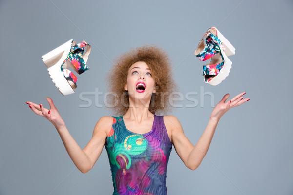 興奮した 気楽な 若い女性 驚いた 飛行 靴 ストックフォト © deandrobot