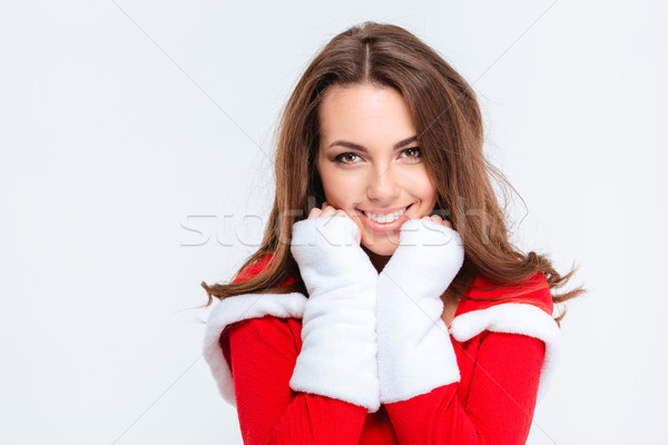 Charming cheerful girl in red santa claus costume  Stock photo © deandrobot