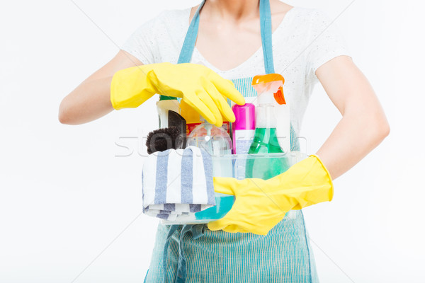Detergents holded by young housewife in blue kitchen apron Stock photo © deandrobot