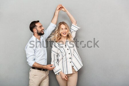 Playful funny bearded man making bunny ears by hands Stock photo © deandrobot