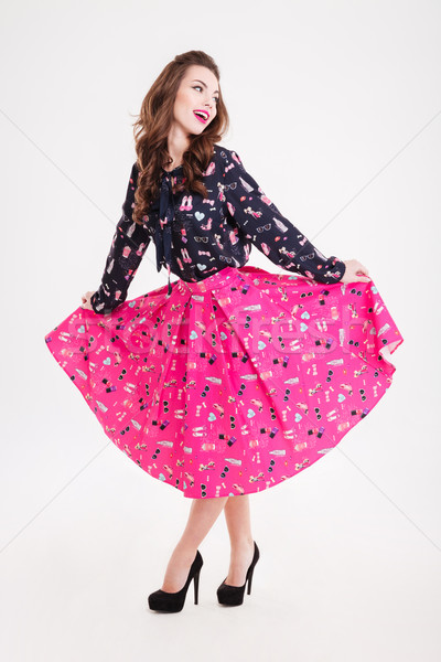 Happy woman with long curly hair and bright pink lips Stock photo © deandrobot