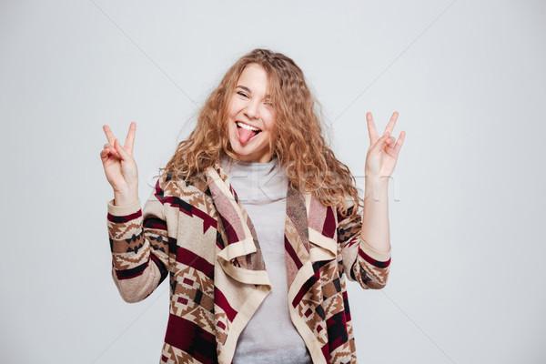 Engraçado mulher língua câmera isolado Foto stock © deandrobot