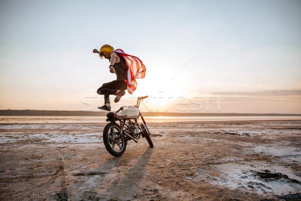 Brutális férfi ugrik motorkerékpár naplemente sivatag Stock fotó © deandrobot