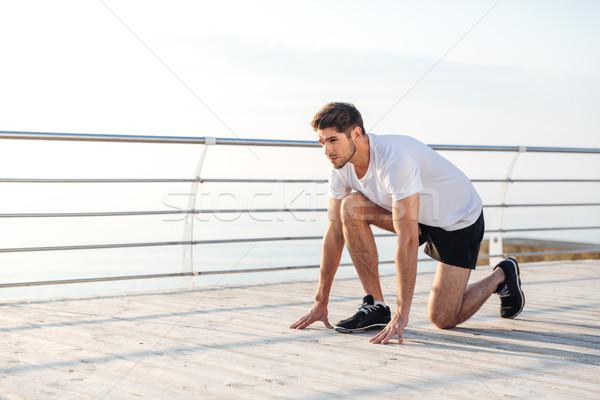 молодые спортсмен готовый запустить утра спорт Сток-фото © deandrobot