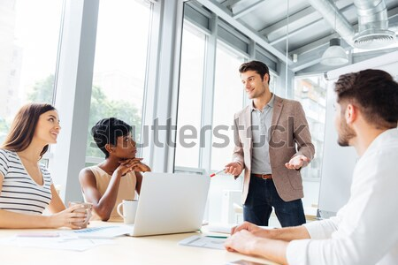 Businessmen shaking hands and ending business meeting in office Stock photo © deandrobot