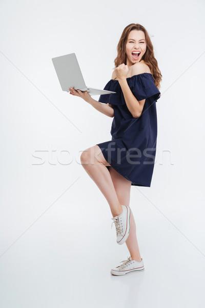 Eccitato laptop Foto d'archivio © deandrobot