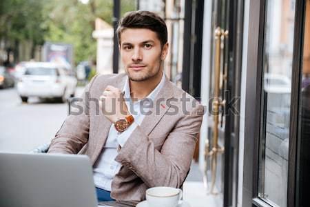 молодые красивый бизнесмен чтение газета кофейня Сток-фото © deandrobot