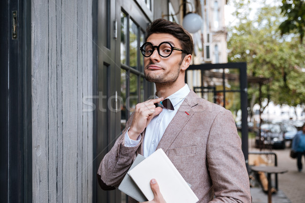 Funny man wearing eyeglasses and bow at the cafe Stock photo © deandrobot