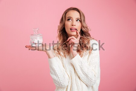Hungry bearded man in dirty shirt biting hotdog Stock photo © deandrobot