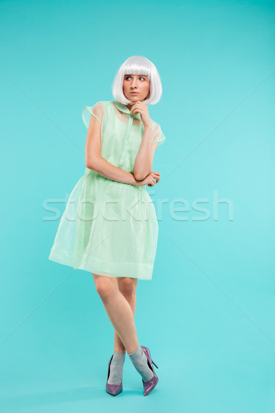 Attractive blonde young woman in dress and high heels shoes Stock photo © deandrobot