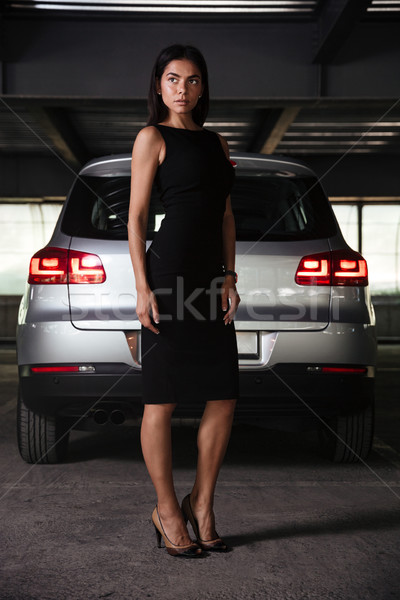 Zakenvrouw permanente auto ondergrondse parkeren mooie Stockfoto © deandrobot