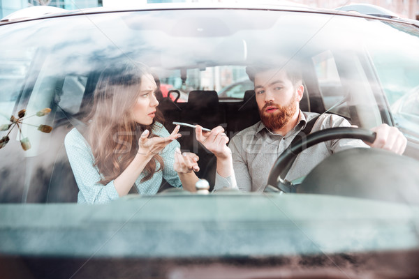 Quarrel of young couple in car Stock photo © deandrobot