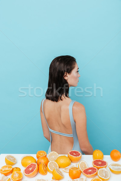 Stockfoto: Achteraanzicht · vrouw · vergadering · tabel · sinaasappelen · meisje