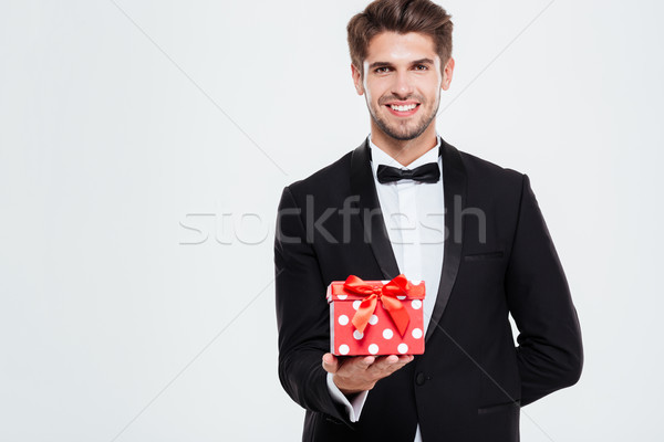 Cool businessman with gift Stock photo © deandrobot