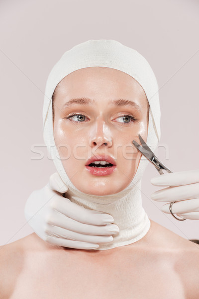 Unusual portrait of scared model Stock photo © deandrobot