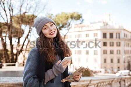 Happy attractive young woman walking in old city Stock photo © deandrobot
