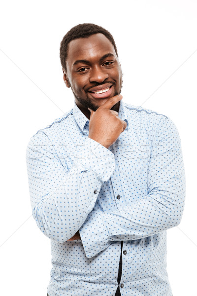 Smiling young african man dressed in shirt Stock photo © deandrobot
