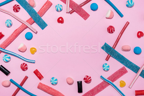 Mixed colorful candies jellies with copyspace in the middle Stock photo © deandrobot
